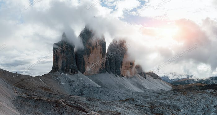 Landscape of three peaks of majestic Tre Cime mountains in the morning with clear sky over it