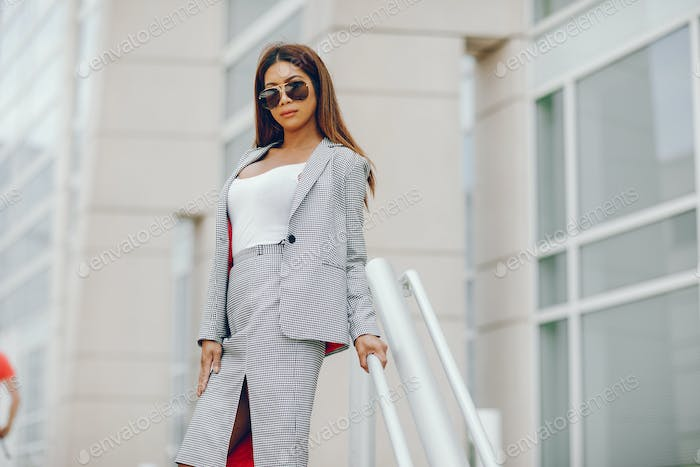 businesswoman in a summer city