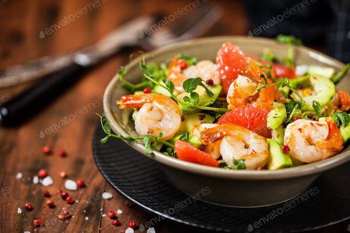 Delicious fresh salad with prawns, grapefruit, avocado, cucumber
