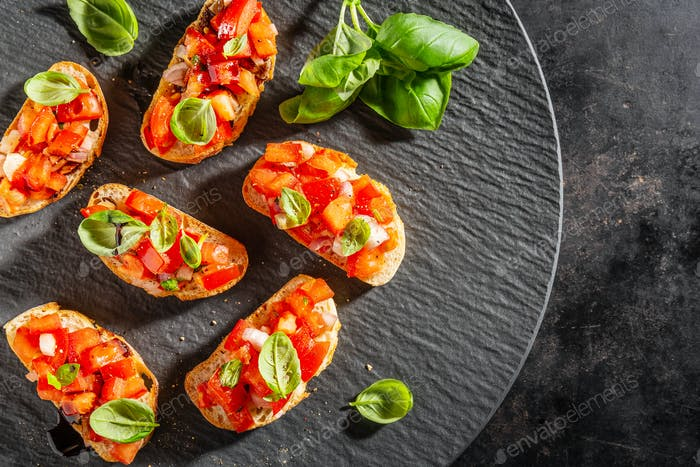Classic italian bruschetta served on dark plate