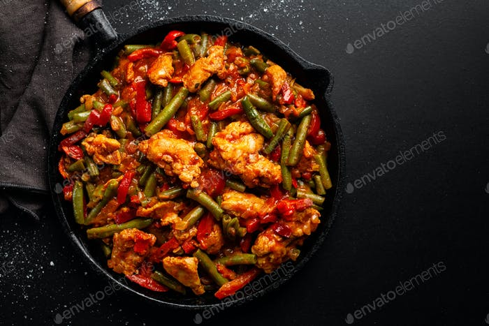 Stuffed meat with vegetables on pan