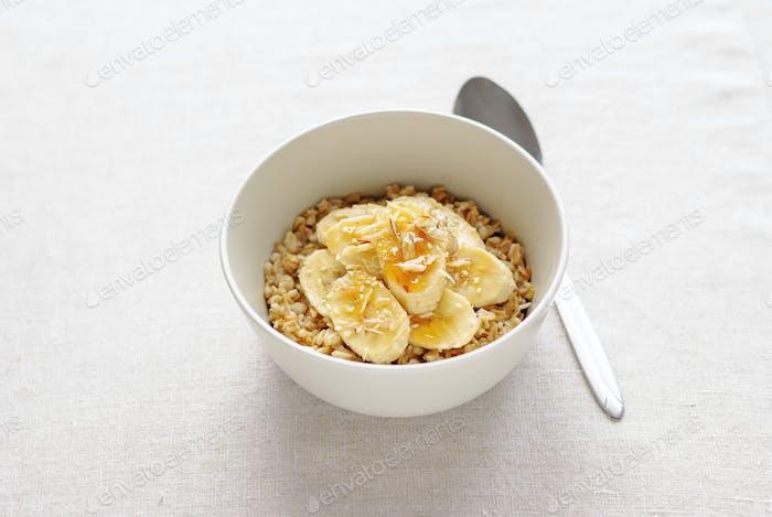 Bowl of oatmeal with sweet banana