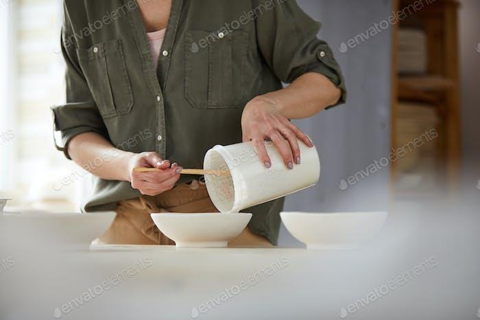 Potter Mixing Glaze