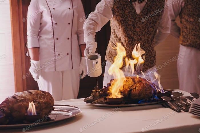 Delicious meat in fire at wedding reception in restaurant
