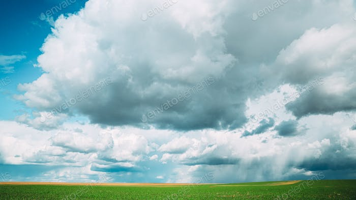Amazing Natural Bright Dramatic Sky With Rain Clouds Above Countryside Rural Field Meadow Landscape