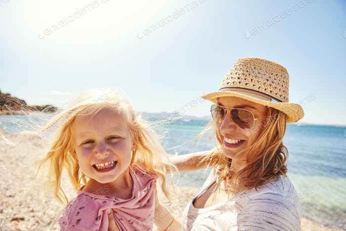 Happy mother and daughter at the beach