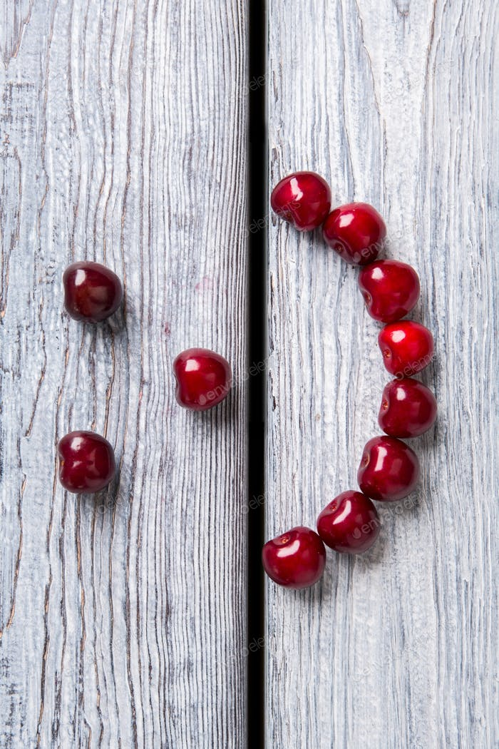 Smiley face made of cherries
