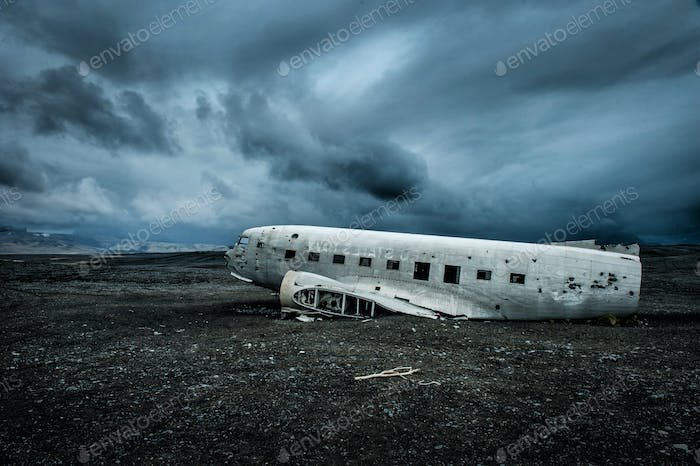 The remains of a crashed plane. Iceland. Side of volcanic beach.