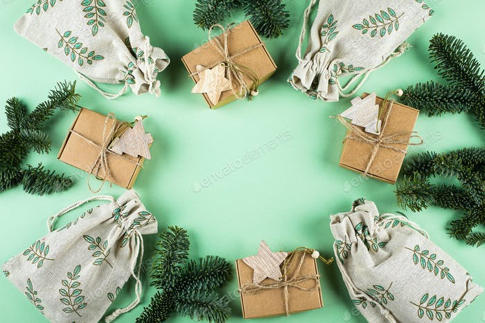 Zero Waste Gift Wrapping Holiday Season Eco-friendly Lifestyle. Boxes and Pouches with fir branch.