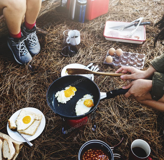 Friends Camping Morning Breakfast Cookking Concept