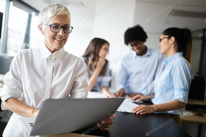 Group of young business people working and communicating at the office