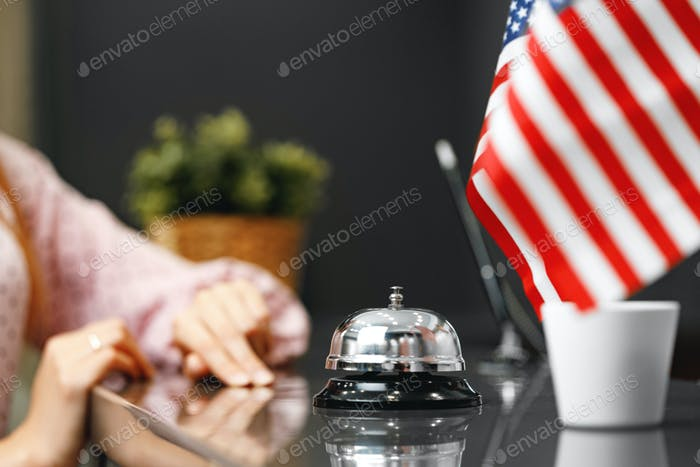 Hotel service bell on front desk counter