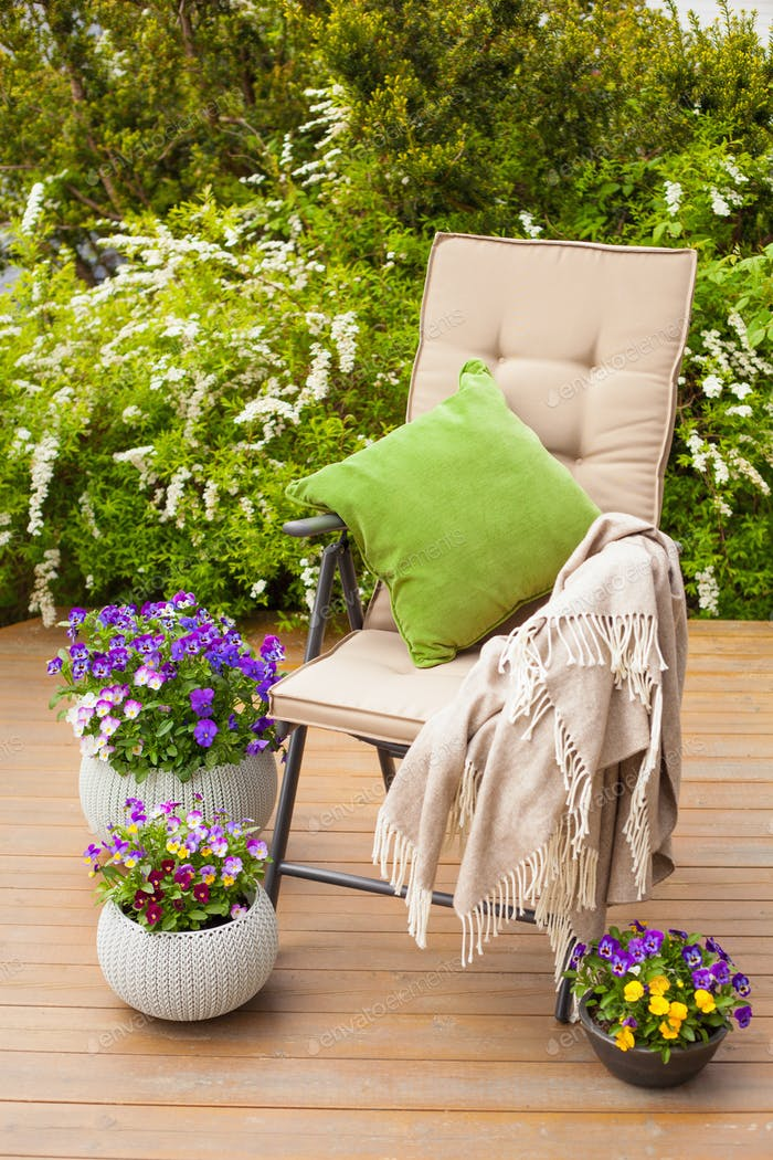 garden chair on terrace, pansy flowers