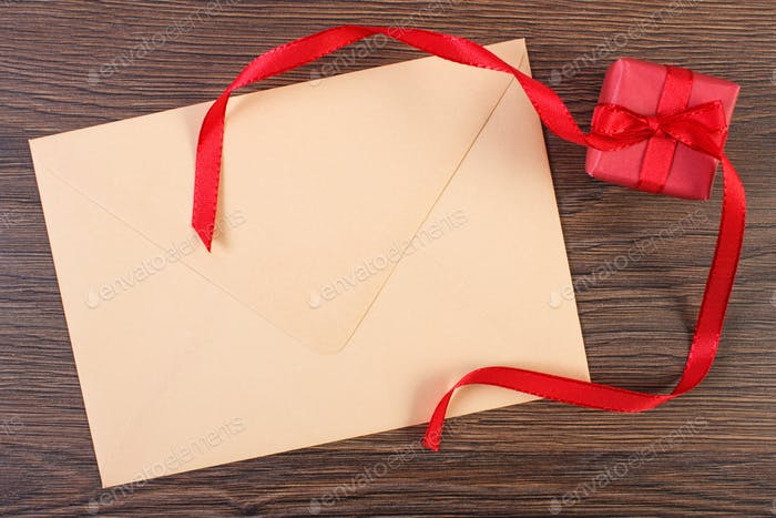 Gift with ribbon and love letter for Valentines Day, copy space for text