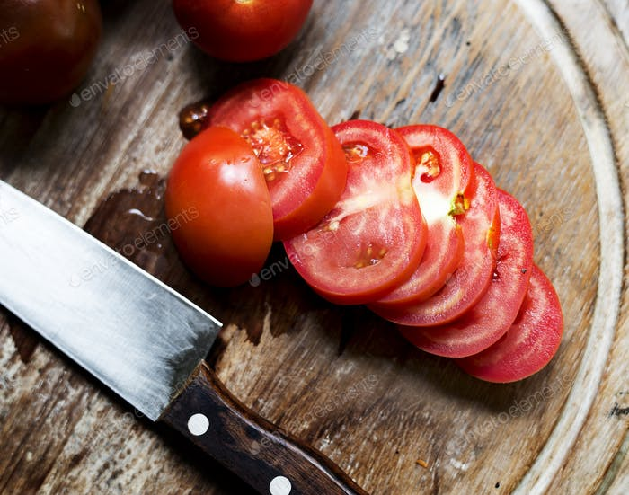 Slice of tomatoes on a cutting board