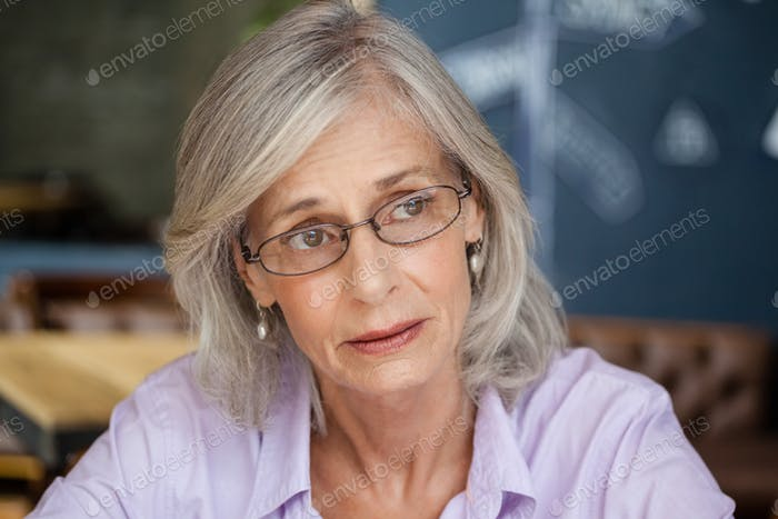 Worried senior woman looking away