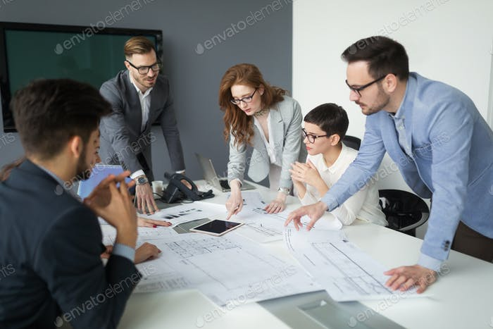 Group of architects working on project