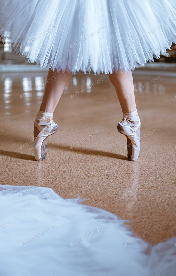 The close-up feet of young ballerina in pointe shoes