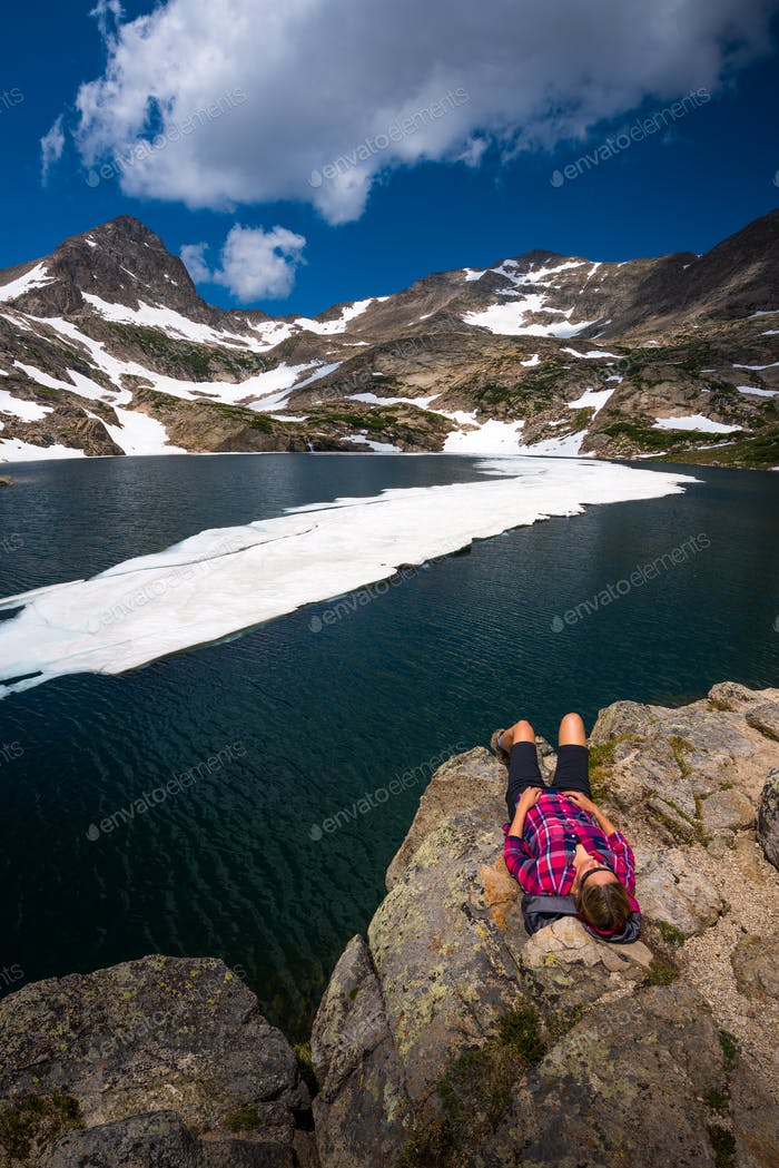 Tourist in Colorado Hiker Girl rests at Blue lake