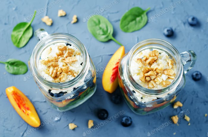 Spinach peach blueberry goat cheese walnuts salad in a jar
