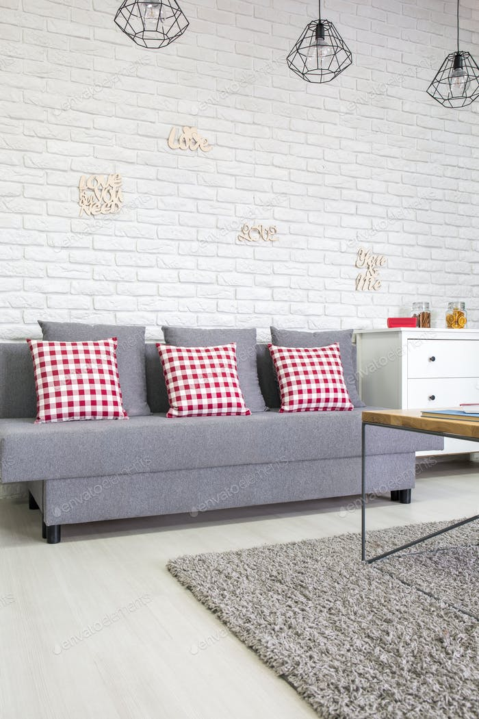 Sofa with red pillows