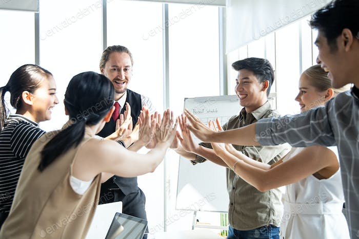 Group business people with join hands of teamwork.