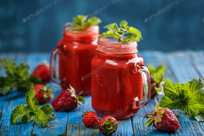 Strawberry smoothie in the glass jars