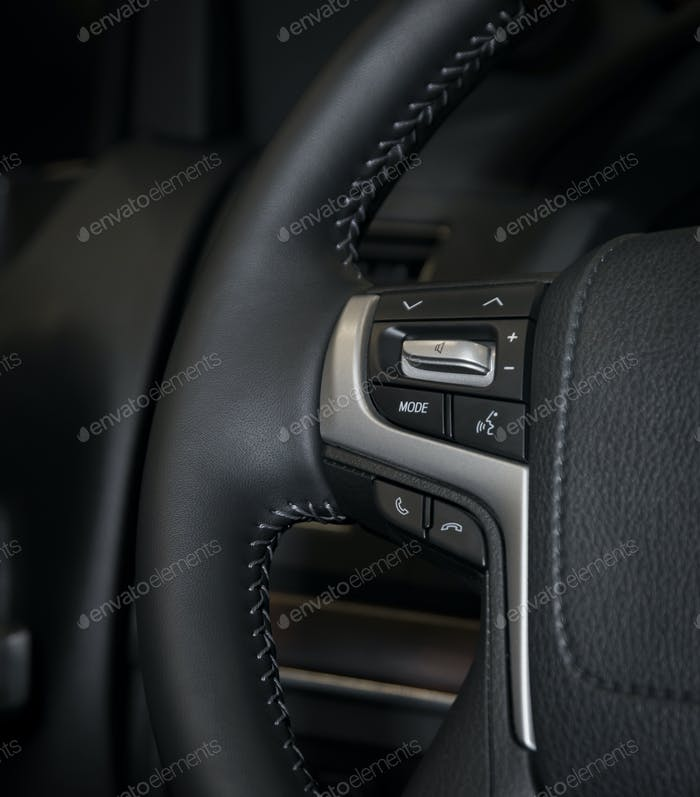 Media control buttons in modern luxury car interior
