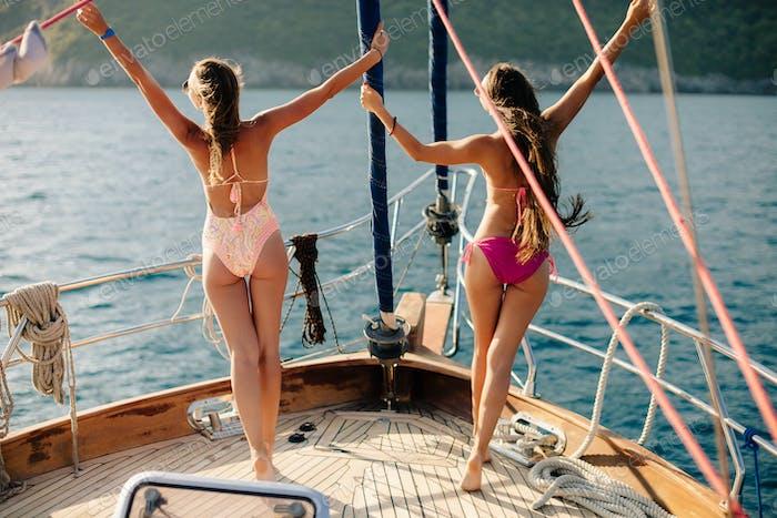 joyful women yachting