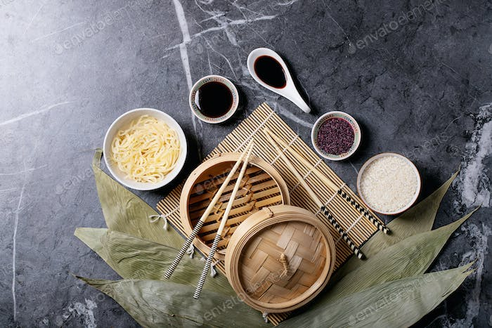 Noodles and rice on bamboo leaves