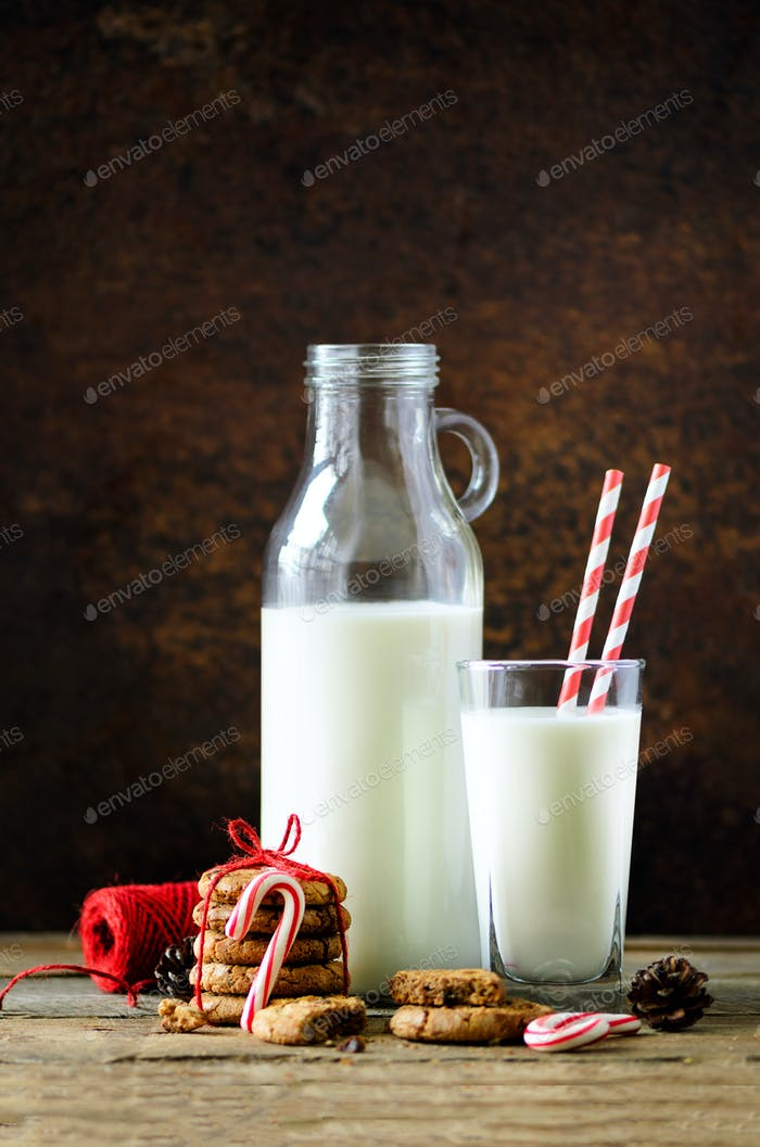 Christmas dark background with snow and bokeh, copy space. Bottle, glass with milk for Santa