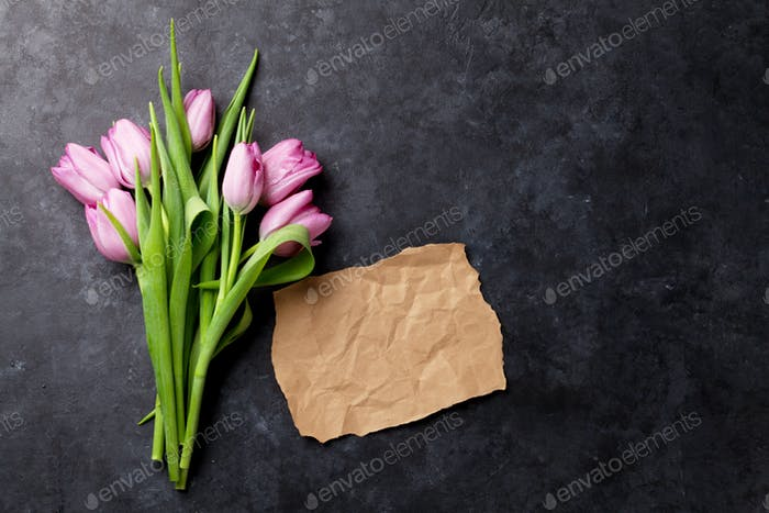 Fresh purple tulip flowers and paper for note