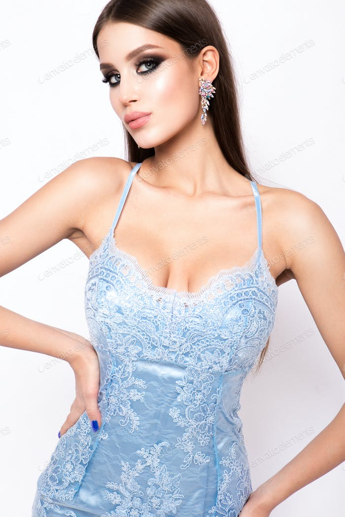 Fashion photo of young magnificent woman in luxury dress.