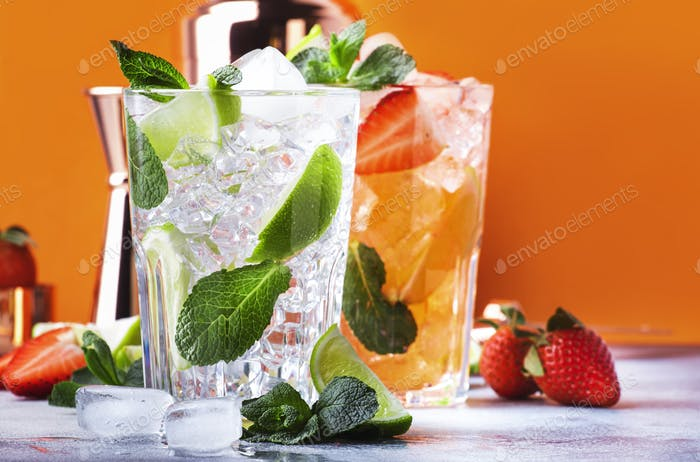 Fresh Mojito cocktail set with lime, mint, strawberry and ice in glass on orange background