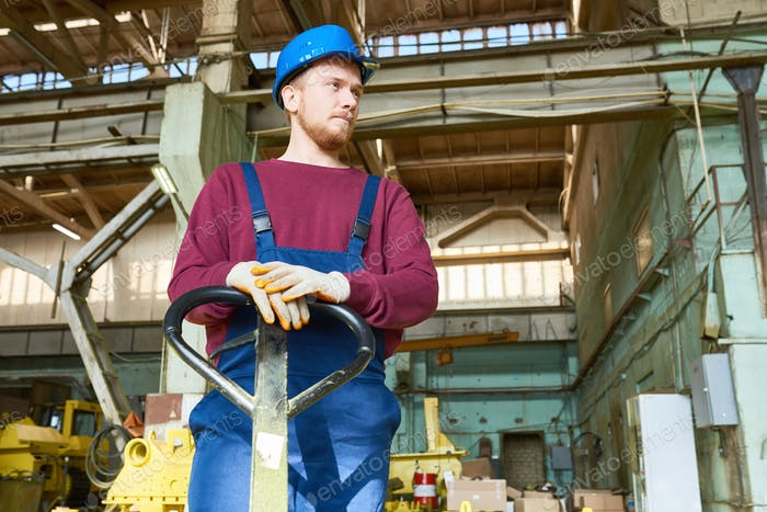 Young Factory Worker at Spacious Warehouse
