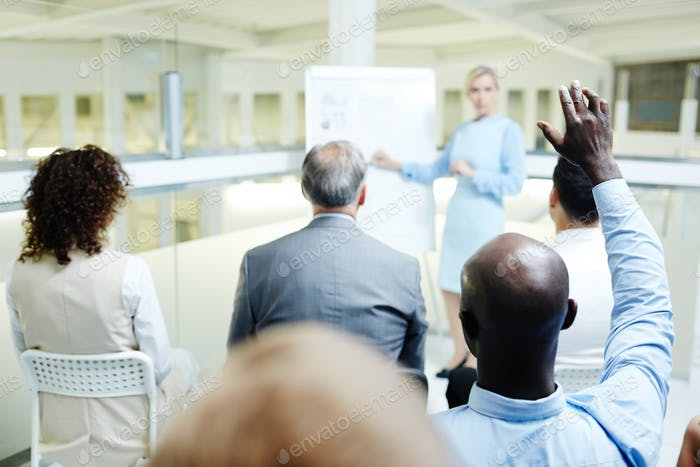 Attendant raising hand