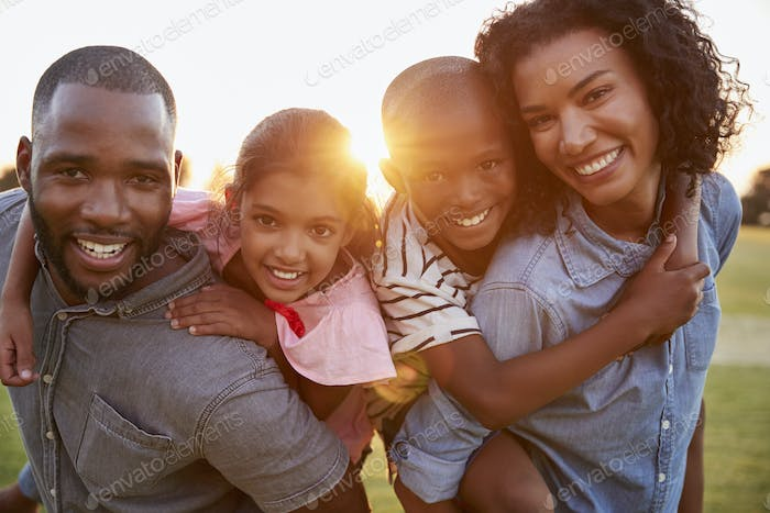 Young black couple with children on piggyback