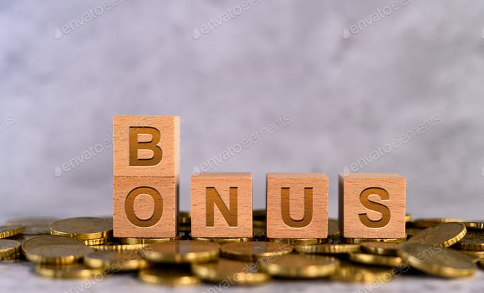 Bonus word alphabet wooden cube letters placed on a gold coin