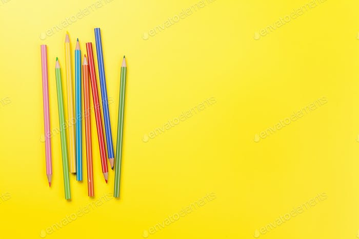 Office yellow backdrop with colorful pencils