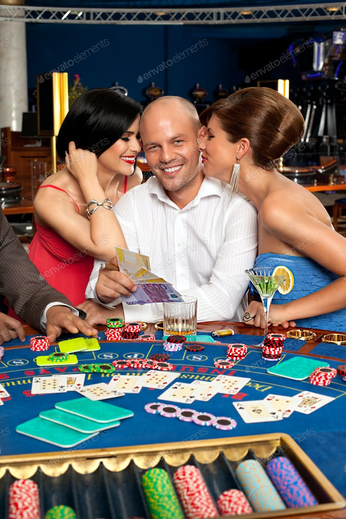 wealthy blackjack player flirting with two women