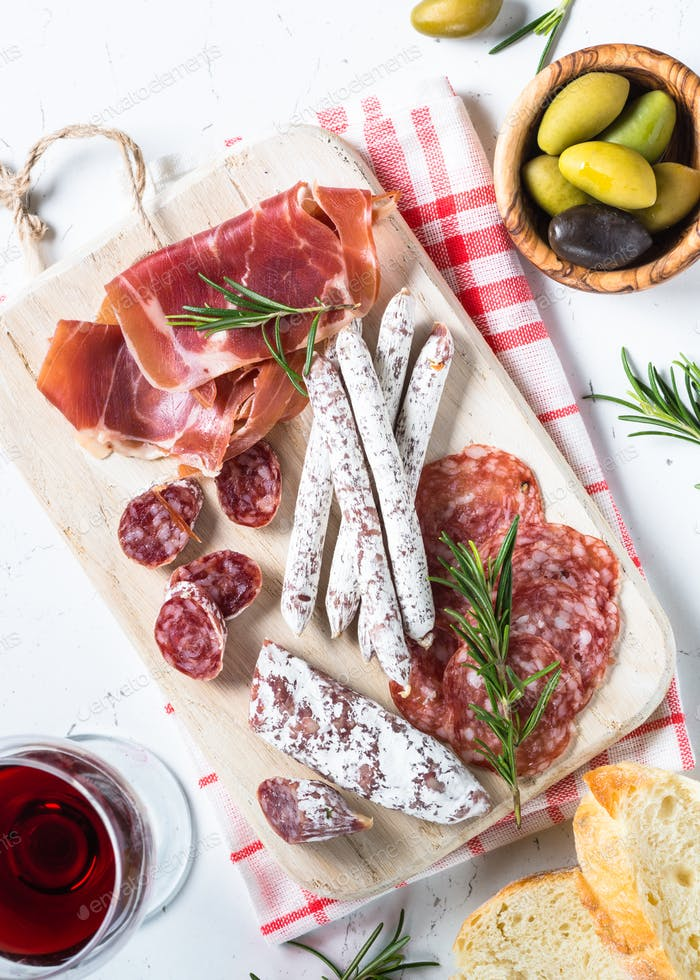 Traditional italian antipasto on white
