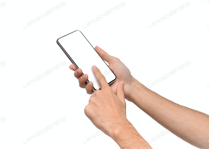 Male hands using smartphone with blank screen on white background