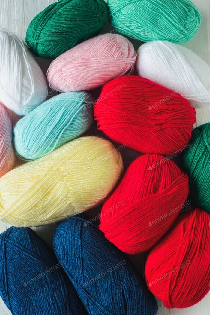 colorful oval acrylic colorful wool yarn thread skeins background