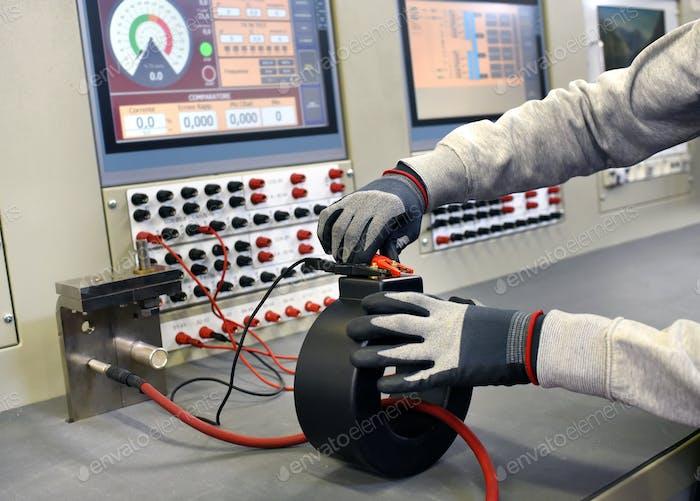 Workman testing a new transformer