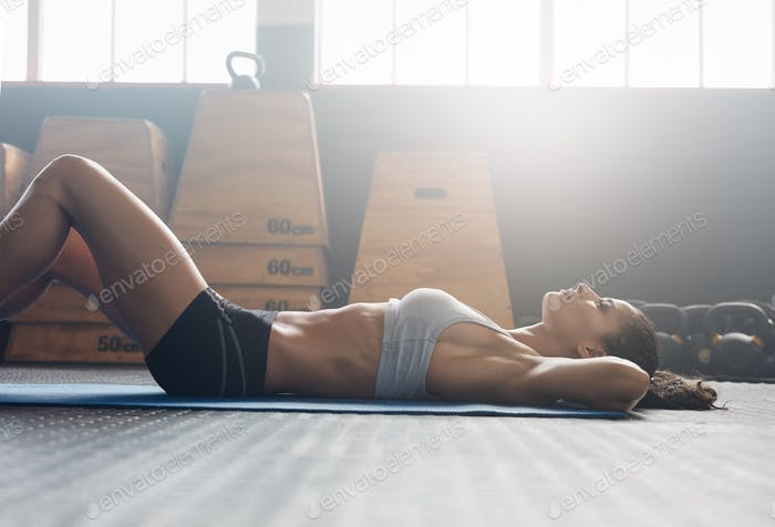 Fitness woman doing sit ups at gym