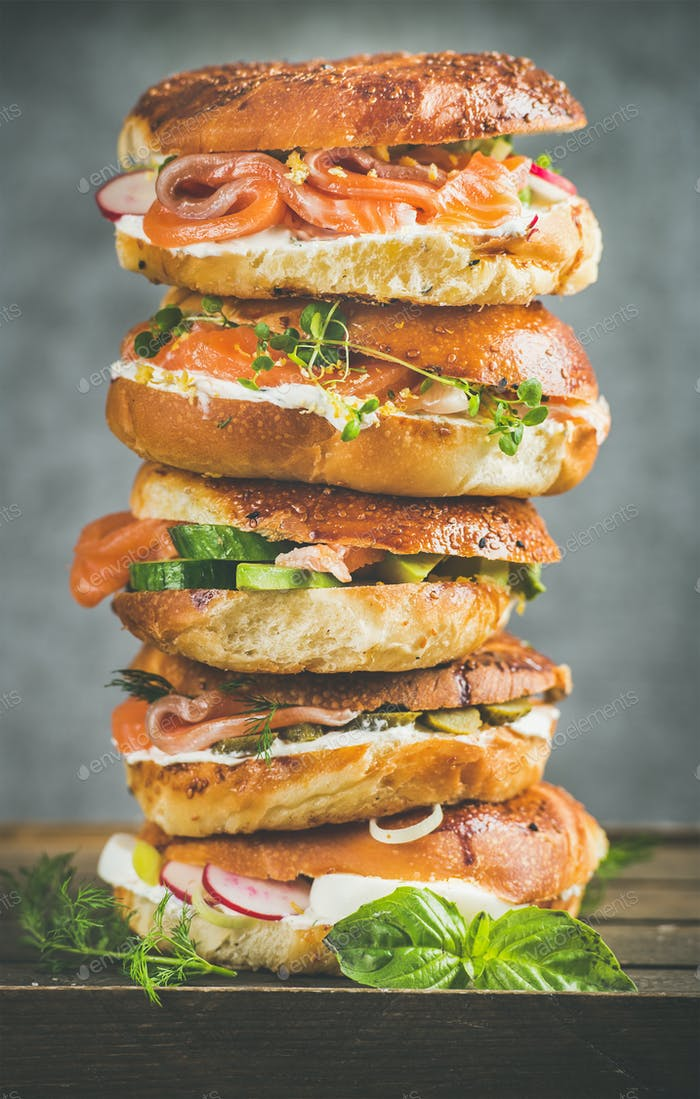 Heap of Bagels with salmon, eggs, vegetables, capers, cream-cheese, herbs
