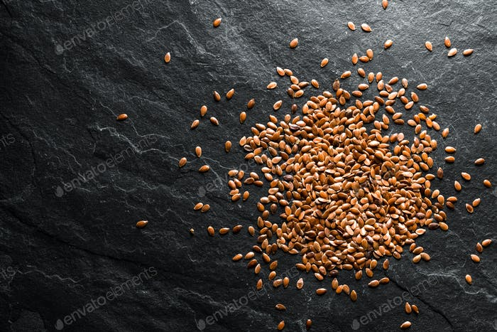 Flax seeds for germination on gray shale