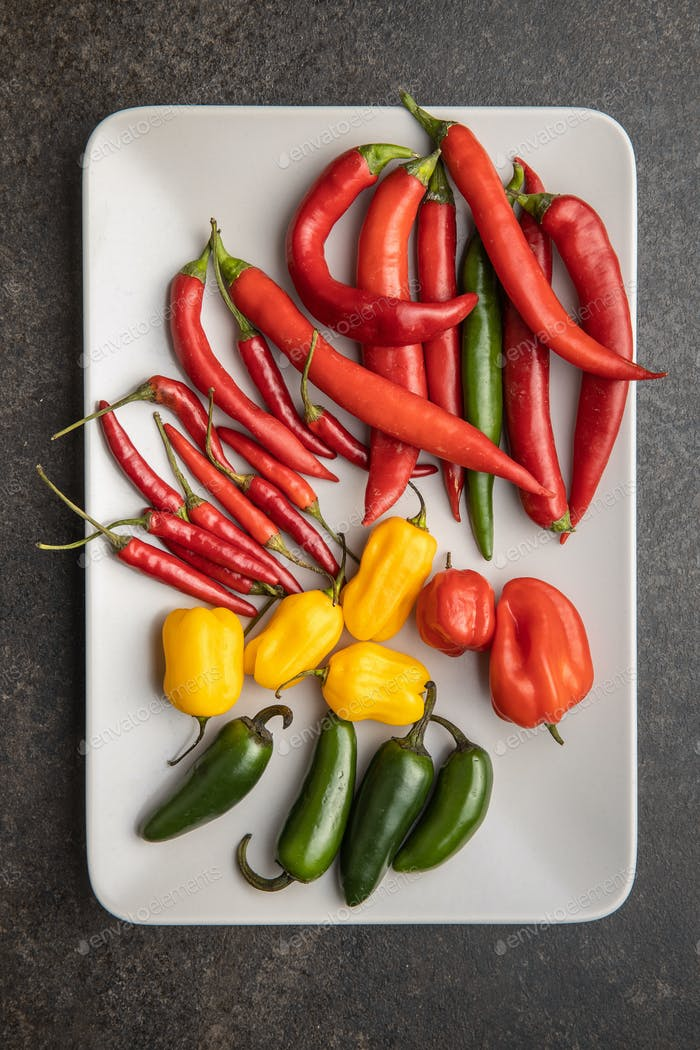 Various types of chili peppers. Chili, habanero and jalapeno peppers. Red, green and yellow peppers.