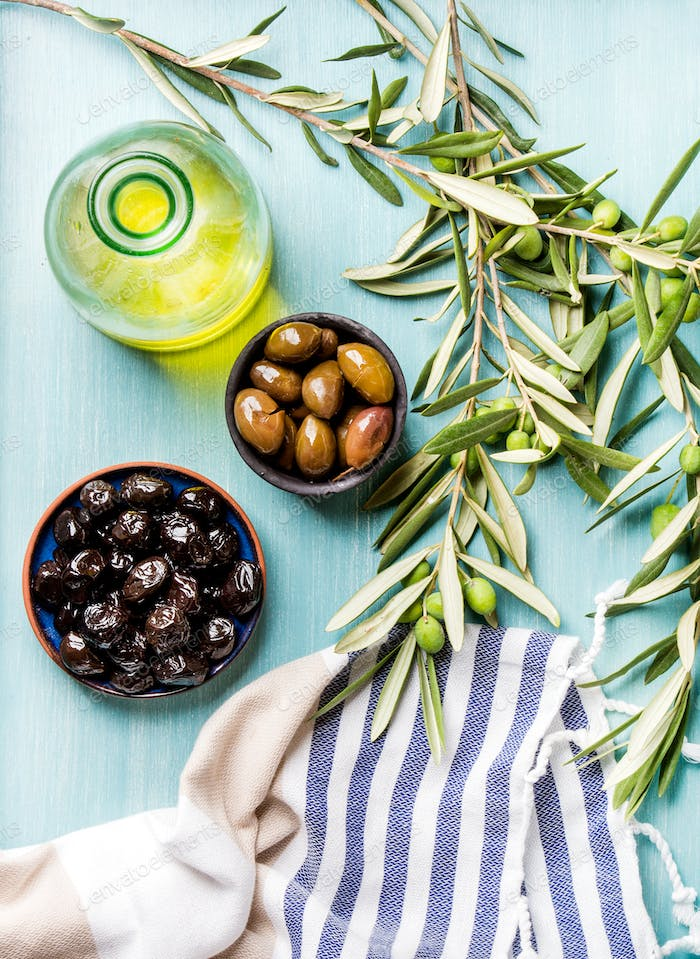 Two bowls with pickled green and black olives