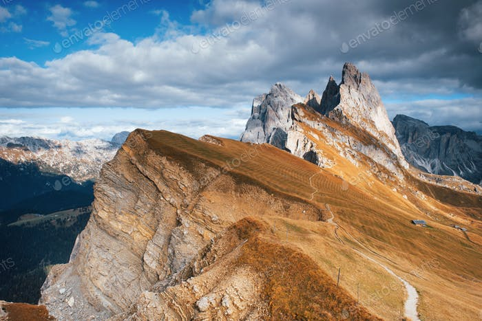 Little trails for tourists. Outstanding hills of the Seceda dolomite mountains at daytime